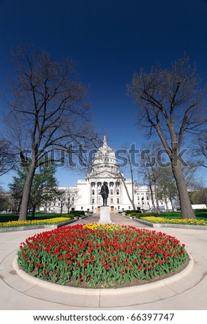 Wisconsin state capitol building in downtown Madison, Wisconsin is adorned with tulips.