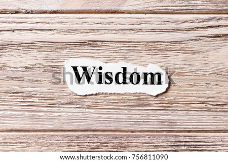 wisdom of the word on paper. concept. Words of wisdom on a wooden background. #756811090