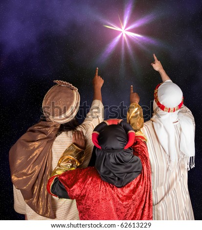 Wisemen Caspar Melchior and Balthasar following the star of Bethlehem