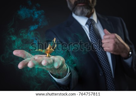 Wish come true, senior businessman holding magic aladdin's lamp, fumes coming out of it #764757811