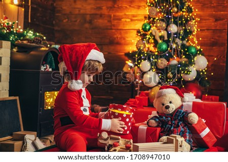 Wish you merry Christmas. Gift emotions. Christmas kids - happiness concept. Winter kid. New year concept. Happy child with Christmas gift box