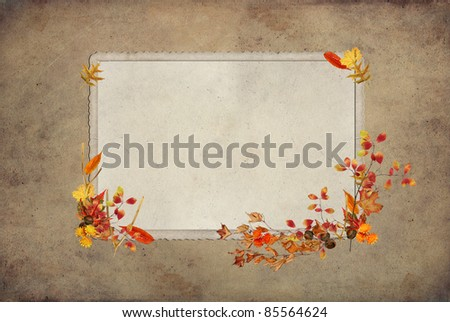 wishbones with fall foliage on vintage frame and textured background