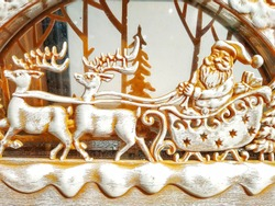 Wishing You A Merry Christmas and Happy Holiday. Wood Handcraft of Santa Claus with White Beard Riding Deer Sleigh Brought Gifts For Christmas in Snowy Day, White Snow Christmas Effect