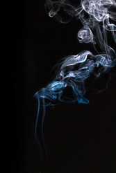 Wisps of insence smoke isolated against background