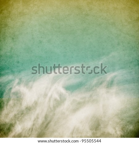 Wispy spring clouds on a textured, vintage paper background with grunge stains.