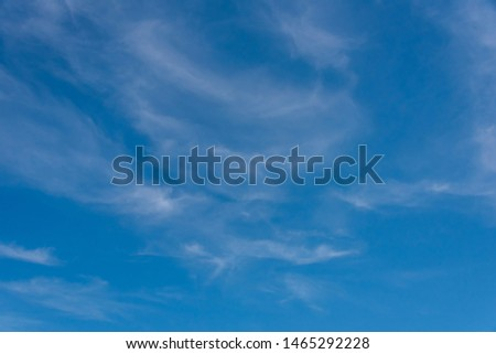Wispy Thin Clouds in a Blue Sky on a Windy Day