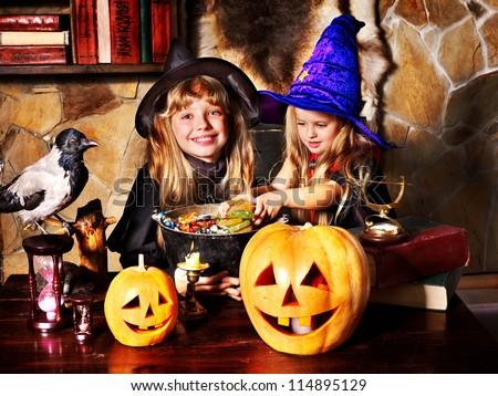 Witch  children with pumpkin lantern. Halloween.