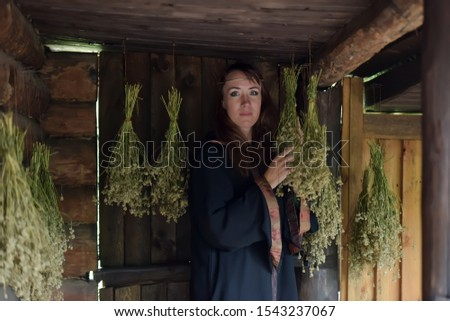 witch, healer with dried herbs