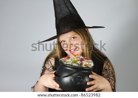 Witch Holding Cauldron filled with lollies