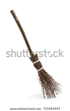 Witch's magic broom isolated on white background