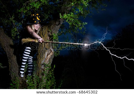 Witch strikes lightning from the broomstick sitting on the tree