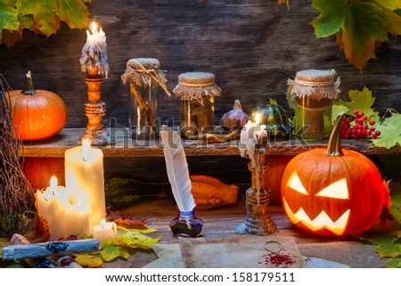 Witch table with halloween pumpkin