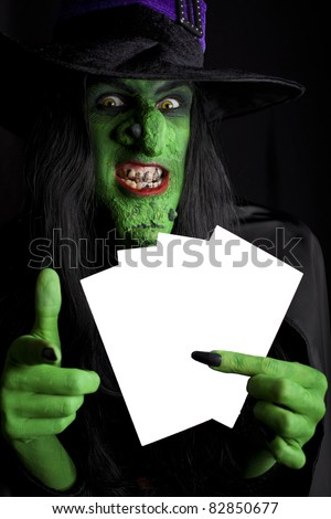 Witch with space for text, black background.