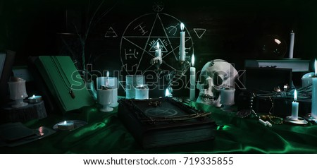 Stock Photo Witchcraft composition with burning candles, human skull, magic books, jewelry, tarot cards and pentagram symbol. Halloween and occult concept, black magic ritual.