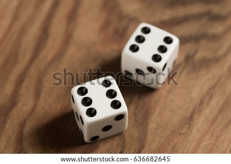 wite dices with number 6 o wooden table #636682645