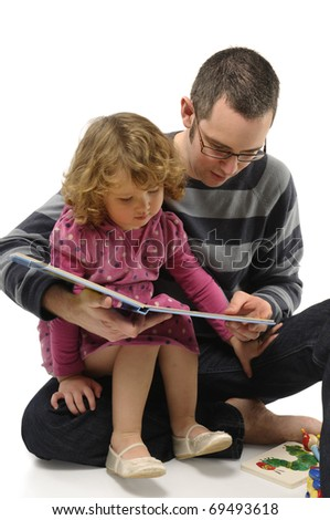 With dad, reading fairy tales