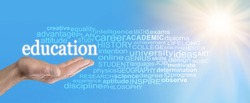 With Education the sky is the limit Word Cloud - male open hand with the word EDUCATION floating above surrounded by relevant words on a blue sky and sun burst background
