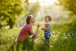 With mommy and dandelions