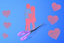 With scissors we cut out the applique of a girl kissing a boy on the sides of a heart.