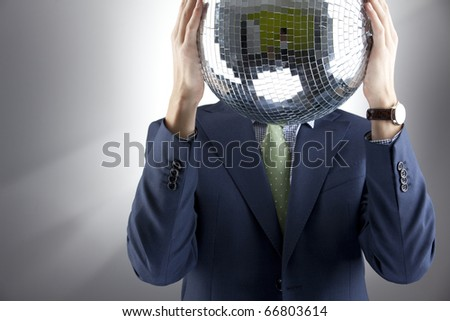 with silver disco ball instead of head on grey background