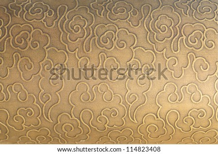 With the metal decorative pattern of the stone wall