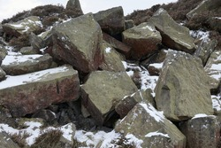 With tribute to the industrial past of Nidderdale, a heap of discarded rocks showing drilling marks