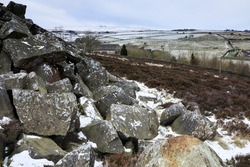 With tribute to the industrial past of Nidderdale, a view through discarded rocks and spoil heaps