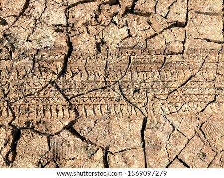 Without seasonal rain the bottom of a catchment dam turns to bone dry and cracked clay under the hot desert sun in Ras Al Khaimah emirate in the United Arab Emirates.