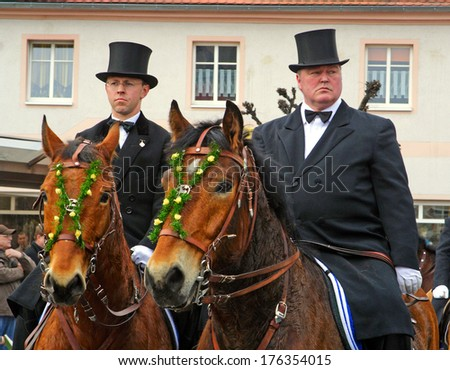 WITTICHENAU, GERMANY - EASTER SUNDAY 4 APRIL: The Easter Riders of Upper Lusatia  announce the news of Jesus resurrection on April 4, 2010 in Wittichenau. This announcement parade happens every year.