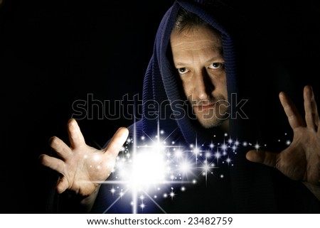 Wizard witg glowing stars between your hand