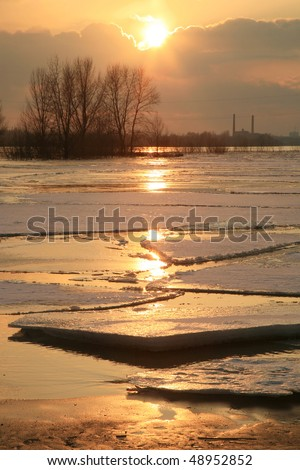 Wloclawek in Poland - sunset. Hacked off with ice the Vistula, ice floe on the river.