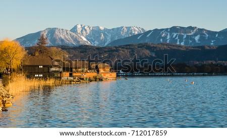 Photo of  Woerthersee in Klagenfurt and Karawanken mountains in background.Austria.