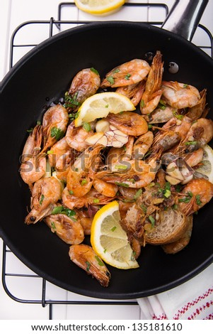 wok stir fry shrimps  with garlic and parsley