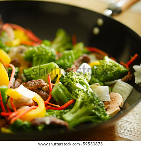 Stock Photo wok stir fry with selective focus