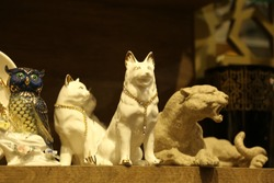 Wolf statue, trinket as a decoration object on flat background