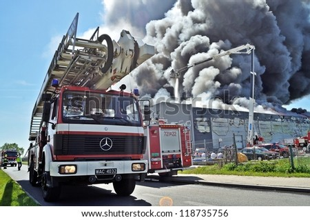 WOLKA KOSOWSKA, POLAND - MAY 10: Firefighters extinguish a raging fire in a China Mart storehouse, May 10, 2011 in Wolka Kosowska, Poland. The fire burned 150 storage units covering nearly 2 hectares