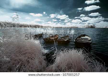 Wolsztyn Lake and boats in Greater Poland, Poland. The infrared image