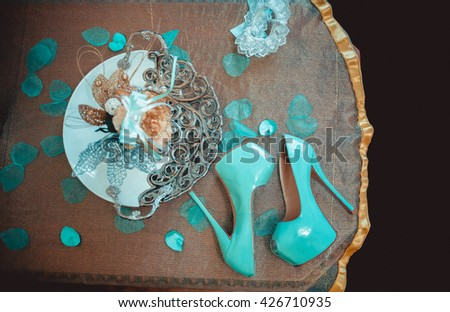 Woman accessories of turquoise and peach color isolated on white background, top view #426710935