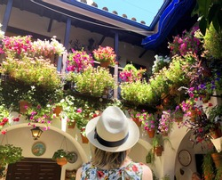Woman admiring flowers in Andalusia, Spain