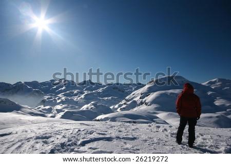 Woman admiring winter mountains