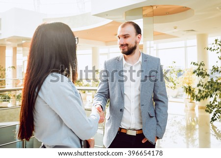 Woman adviser with a businessman. In the office #396654178