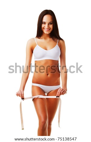 Woman after diet with measure on white background