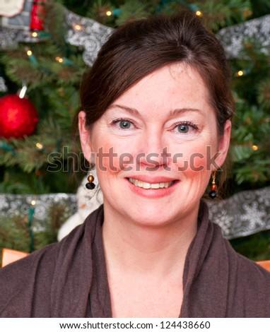 Woman against Christmas tree
