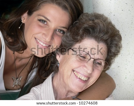 woman aged and young girl smiling