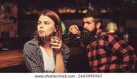 Woman alcoholic beverage in bar. Female male alcoholism. Woman and man alcoholism. Alcoholism, alcohol addiction, male alcoholic. Young man drinking alcohol. Young woman has problems with alcohol.