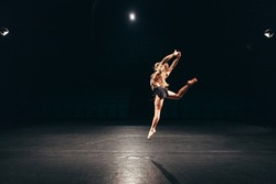 woman alone on stage doing modern dance performance