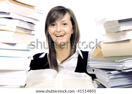 woman and a pile of books - stock photo