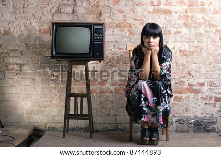 woman and an old television