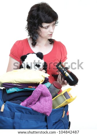 woman and baby daughter crammed full of clothes and blue shoulder bag isolated on white