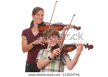 Woman and boy playing violin on white background - stock photo